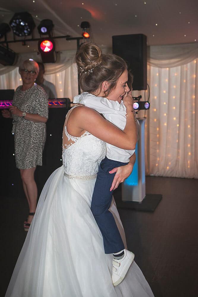 A bride hugs her son at a wedding at Parley Manor, Christchurch.