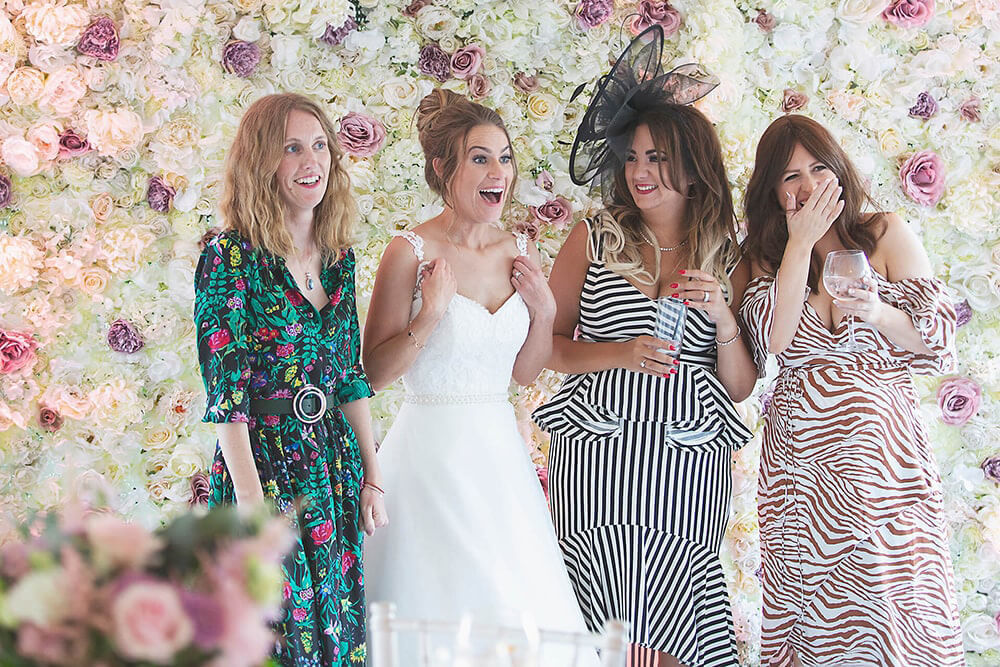 A bride and her girlfriends posing for a photo at a wedding at Parley Manor, Christchurch.