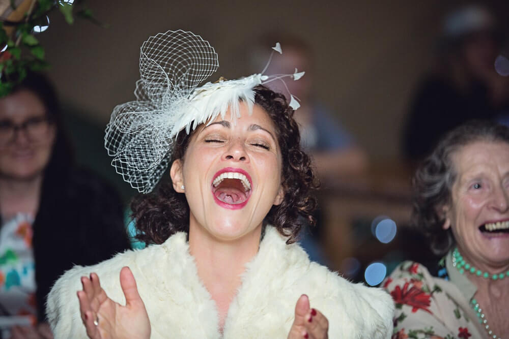 The bride laughs at a beautiful humanistic 1920s wedding in Henfield Sussex.